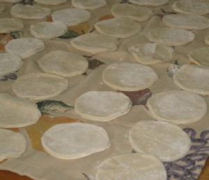 Step 5 - dough circles placed on a floured kitchen towels