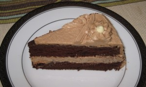 Slice of Cocoa Cake with Peanut Butter Frosting