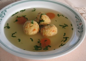 Chicken broth with potato balls (knedle)