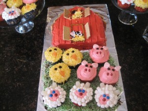 Barn style Birthday Cake with a bunch of farm animals cupcakes