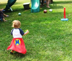 One year-old Super Heroe likes his cape this way